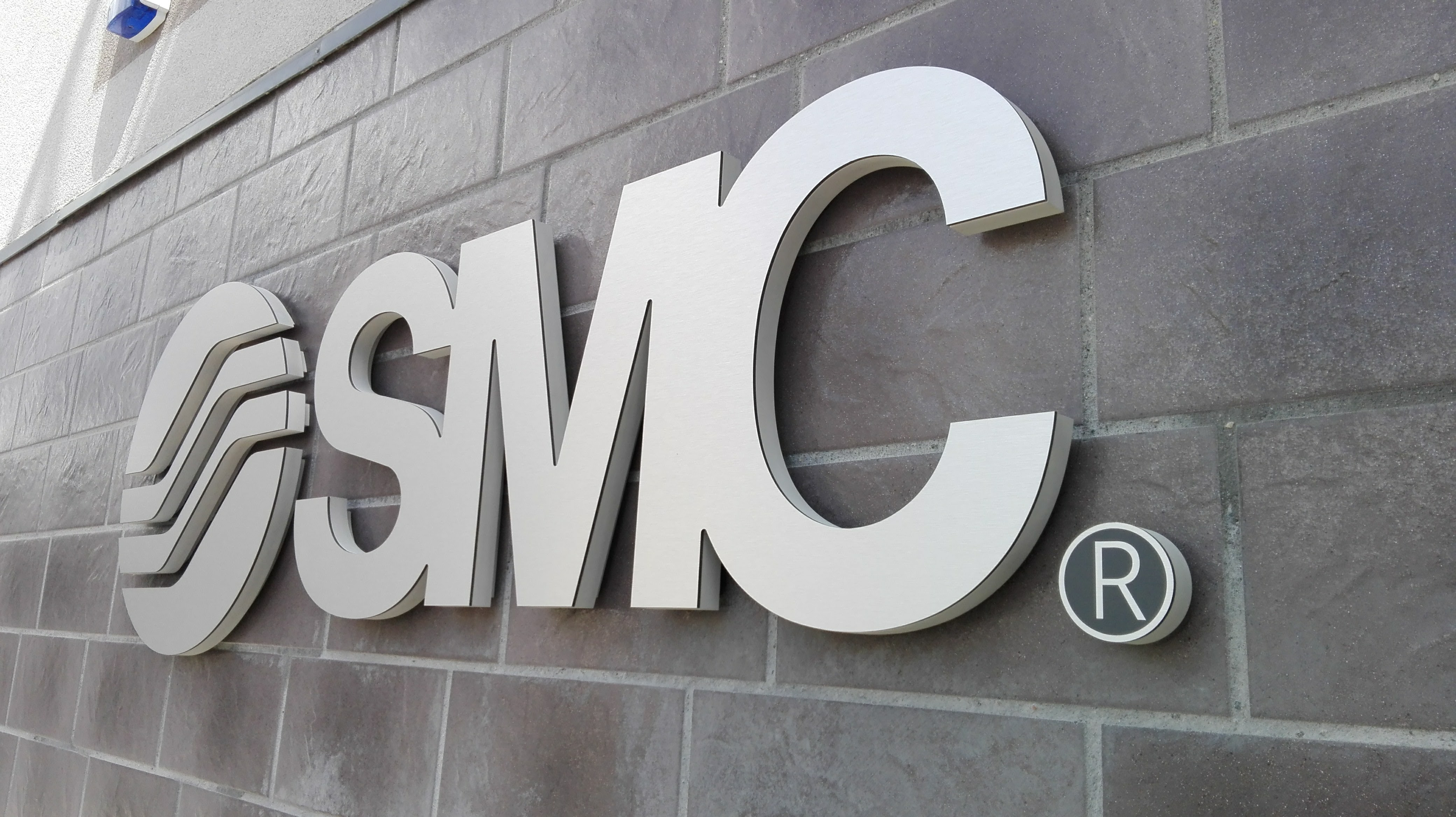 SMC lauko iškaba
